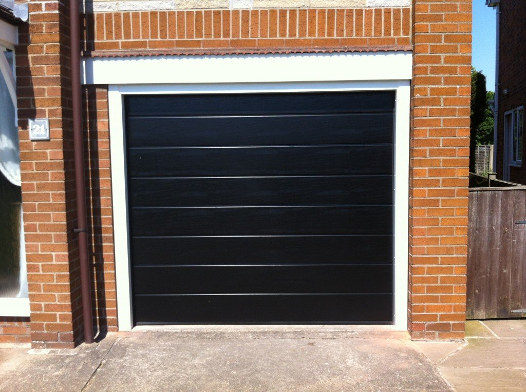Sectional garage doors gallery abi garage doors for Garage doors uk