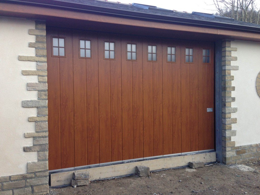 Side Sliding Garage Door In Decograin With Glazing By ABi Garage Doors
